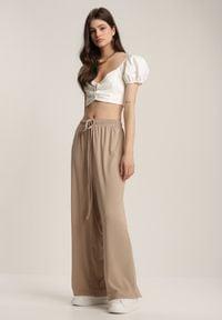 Renee - Beżowe Spodnie Dresowe Celaseis. Kolor: beżowy. Materiał: dresówka