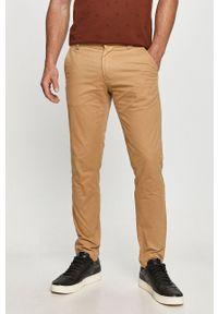 Beżowe spodnie Tommy Jeans