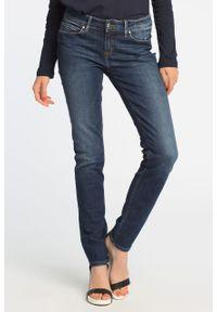 Niebieskie jeansy TOMMY HILFIGER w kolorowe wzory