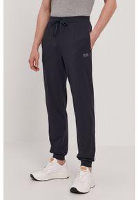 BOSS - Boss - Spodnie. Okazja: na co dzień. Kolor: niebieski. Materiał: dzianina, bawełna. Styl: casual