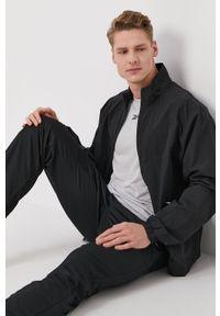 Reebok - Spodnie. Kolor: czarny. Materiał: materiał, tkanina, poliester. Wzór: gładki #3