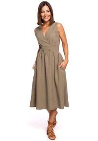 e-margeritka - Sukienka bez rękawów midi kopertowa khaki - s. Kolor: brązowy. Materiał: poliester, wiskoza, materiał. Długość rękawa: bez rękawów. Typ sukienki: kopertowe. Styl: elegancki. Długość: midi
