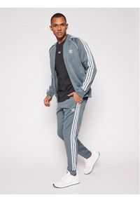 Adidas - adidas Bluza Sst Track GN3516 Szary Regular Fit. Kolor: szary