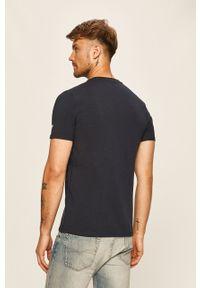 Niebieski t-shirt Guess Jeans na co dzień, casualowy, z nadrukiem