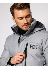 Helly Hansen Kurtka puchowa Tromsoe 53074 Szary Regular Fit. Kolor: szary. Materiał: puch