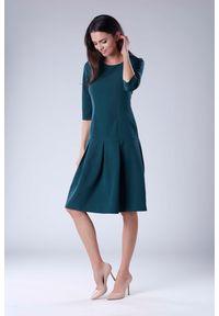 Zielona sukienka wizytowa Nommo wizytowa