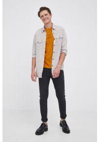 TOMMY HILFIGER - Tommy Hilfiger - T-shirt bawełniany. Okazja: na co dzień. Kolor: żółty. Materiał: bawełna. Wzór: nadruk. Styl: casual