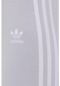 adidas Originals - Legginsy. Kolor: niebieski. Materiał: dzianina
