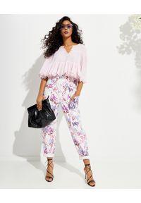 ISABEL MARANT - Spodnie z grafiką Enucie. Stan: podwyższony. Kolor: biały. Materiał: materiał. Długość: długie. Wzór: aplikacja, kolorowy
