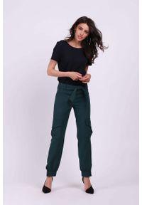 Zielone spodnie z wysokim stanem Nommo