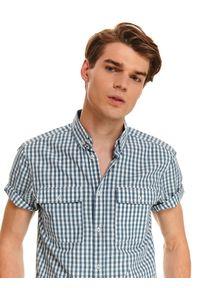 TOP SECRET - Koszula w kratkę o regularnym kroju. Okazja: na co dzień. Kolor: niebieski. Materiał: bawełna. Długość rękawa: krótki rękaw. Długość: krótkie. Wzór: kratka. Styl: casual
