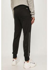 Czarne spodnie dresowe adidas Performance z nadrukiem #4