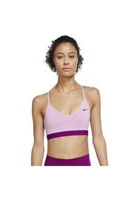 Biustonosz sportowy damski Nike Indy 878614. Materiał: skóra, materiał, poliester. Technologia: Dri-Fit (Nike). Sport: fitness