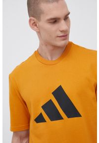 adidas Performance - T-shirt. Okazja: na co dzień. Kolor: pomarańczowy. Materiał: dzianina, materiał. Wzór: nadruk. Styl: casual