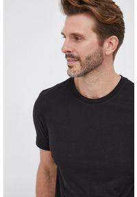 TOMMY HILFIGER - Tommy Hilfiger - T-shirt bawełniany. Okazja: na co dzień. Kolor: czarny. Materiał: bawełna. Wzór: nadruk. Styl: casual