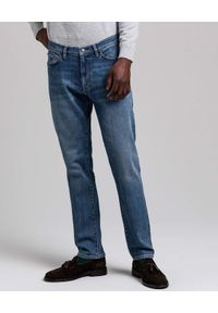 GANT - Niebieskie jeansy Slim Fit. Kolor: niebieski