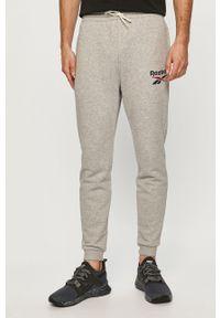 Szare spodnie dresowe Reebok z nadrukiem