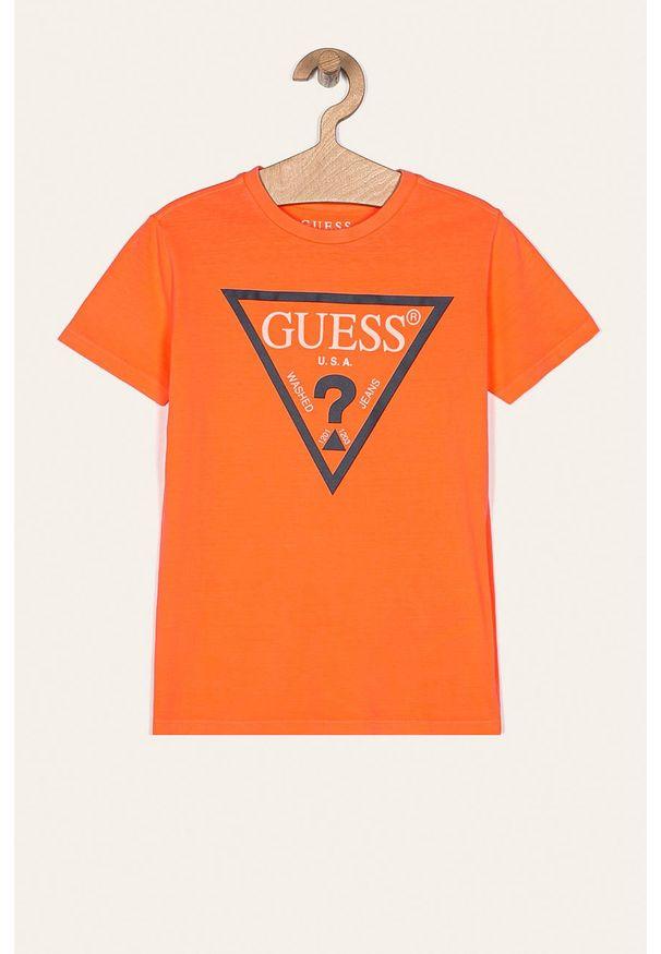 Pomarańczowy t-shirt Guess Jeans casualowy, z nadrukiem, na co dzień, z okrągłym kołnierzem