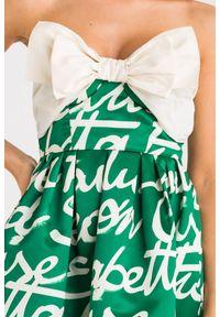 Elisabetta Franchi - SUKIENKA elisabetta franchi. Typ kołnierza: kokarda. Materiał: materiał. Długość rękawa: bez ramiączek. Sezon: lato, wiosna. Typ sukienki: rozkloszowane. Długość: mini