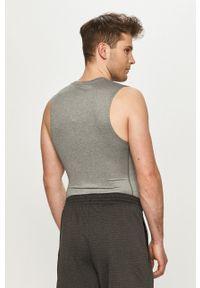 Nike - T-shirt. Kolor: szary. Materiał: tkanina, dzianina, skóra, włókno