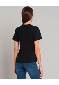 COMME DES GARCONS PLAY - Czarny t-shirt z sercem. Okazja: na co dzień. Kolor: czarny. Materiał: jeans. Styl: klasyczny, casual