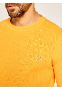 Żółty sweter klasyczny Guess