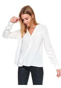 TOP SECRET - Luzna koszula damska z taśmami. Typ kołnierza: dekolt w serek, kołnierzyk stójkowy. Kolor: biały. Długość rękawa: krótki rękaw. Długość: długie. Sezon: jesień, zima. Styl: klasyczny