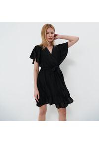 Mohito - Ażurowa sukienka - Czarny. Kolor: czarny. Wzór: ażurowy