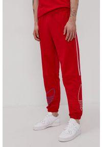adidas Originals - Spodnie. Okazja: na plażę. Kolor: czerwony. Materiał: dzianina, materiał
