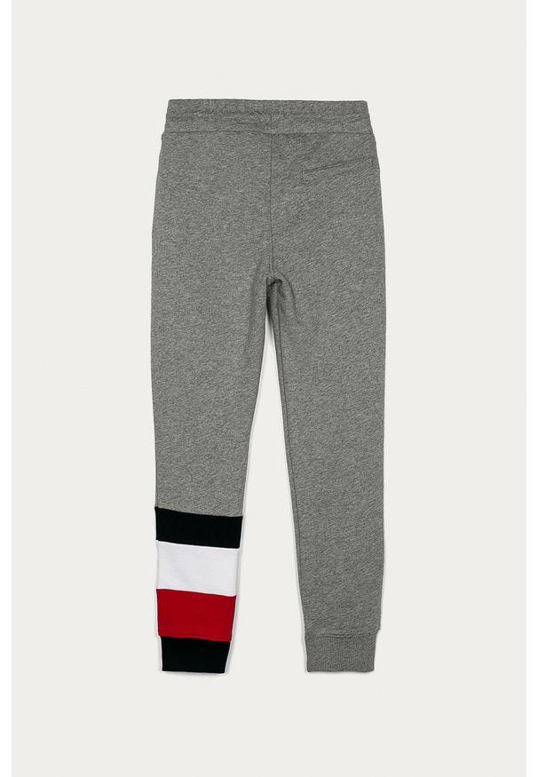 Szare spodnie dresowe TOMMY HILFIGER z aplikacjami, na co dzień