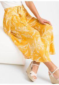 Spodnie z nadrukiem bonprix żółty w kwiaty. Kolor: żółty. Wzór: kwiaty, nadruk