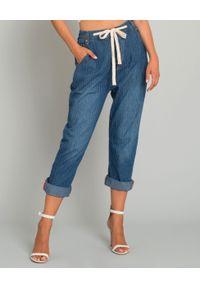 ONETEASPOON - Jeansy w paski z wiązaniem. Stan: podwyższony. Kolor: niebieski. Wzór: paski. Styl: elegancki