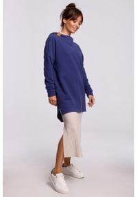 e-margeritka - Bluza długa oversize z kapturem indygo - s/m. Typ kołnierza: kaptur. Materiał: poliester, dzianina, bawełna, materiał. Długość: długie. Wzór: gładki