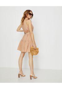ZIMMERMANN - Sukienka mini w grochy. Okazja: na plażę, na spacer. Kolor: beżowy. Materiał: bawełna. Wzór: grochy. Sezon: lato. Typ sukienki: rozkloszowane. Długość: mini