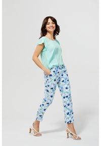 MOODO - Spodnie cygaretki w kwiaty. Materiał: poliester, elastan. Wzór: kwiaty