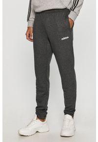 Szare spodnie dresowe Adidas z nadrukiem