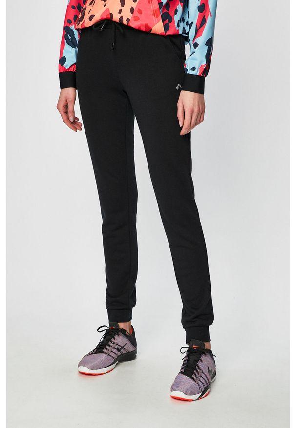 Only Play - Spodnie. Kolor: czarny. Materiał: materiał, dzianina, poliester, bawełna. Wzór: gładki
