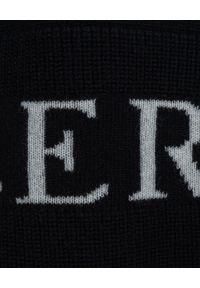 MONCLER - Czarny sweter z golfem. Typ kołnierza: golf. Kolor: czarny. Materiał: kaszmir, wełna. Długość rękawa: długi rękaw. Długość: długie