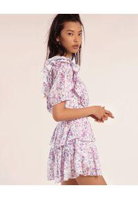 LOVE SHACK FANCY - Wzorzysta sukienka Natasha. Typ kołnierza: kołnierz z falbankami. Kolor: różowy, wielokolorowy, fioletowy. Materiał: bawełna. Wzór: kwiaty. Styl: klasyczny. Długość: mini