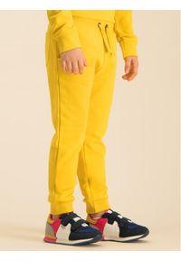 Żółte spodnie dresowe Guess