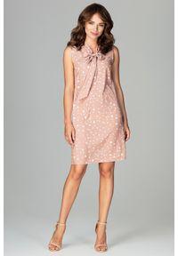 Lenitif - Elegancka sukienka w kropki wiązany dekolt. Typ kołnierza: kołnierzyk stójkowy. Materiał: elastan. Długość rękawa: bez rękawów. Wzór: kropki. Styl: elegancki