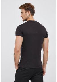 Calvin Klein Jeans - T-shirt bawełniany. Okazja: na co dzień. Kolor: czarny. Materiał: bawełna. Wzór: aplikacja. Styl: casual