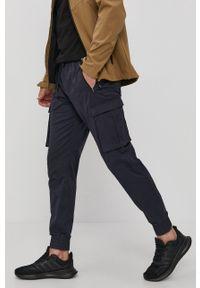 4f - 4F - Spodnie. Okazja: na co dzień. Kolor: niebieski. Styl: casual
