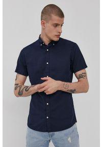 PRODUKT by Jack & Jones - Produkt by Jack & Jones - Koszula. Okazja: na co dzień. Typ kołnierza: kołnierzyk klasyczny. Kolor: niebieski. Materiał: tkanina. Długość rękawa: krótki rękaw. Długość: krótkie. Wzór: gładki. Styl: klasyczny, casual