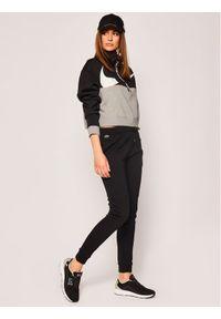 Czarne spodnie dresowe Lacoste