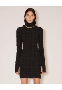 NANUSHKA - Czarna sukienka mini Velma. Typ kołnierza: golf. Kolor: czarny. Materiał: tkanina. Długość rękawa: długi rękaw. Typ sukienki: dopasowane. Długość: mini