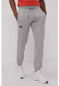Superdry - Spodnie. Kolor: szary