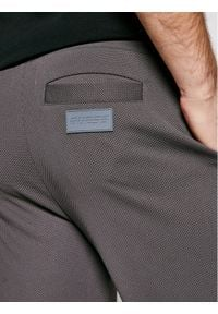 Brązowe spodnie dresowe Guess