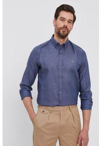 Lacoste - Koszula bawełniana. Okazja: na co dzień. Typ kołnierza: button down. Kolor: niebieski. Materiał: bawełna. Długość rękawa: długi rękaw. Długość: długie. Styl: casual