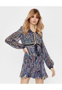 Camilla - CAMILLA - Jedwabna sukienka mini. Okazja: na imprezę. Kolor: niebieski. Materiał: jedwab. Wzór: motyw zwierzęcy, aplikacja. Typ sukienki: rozkloszowane, dopasowane. Długość: mini